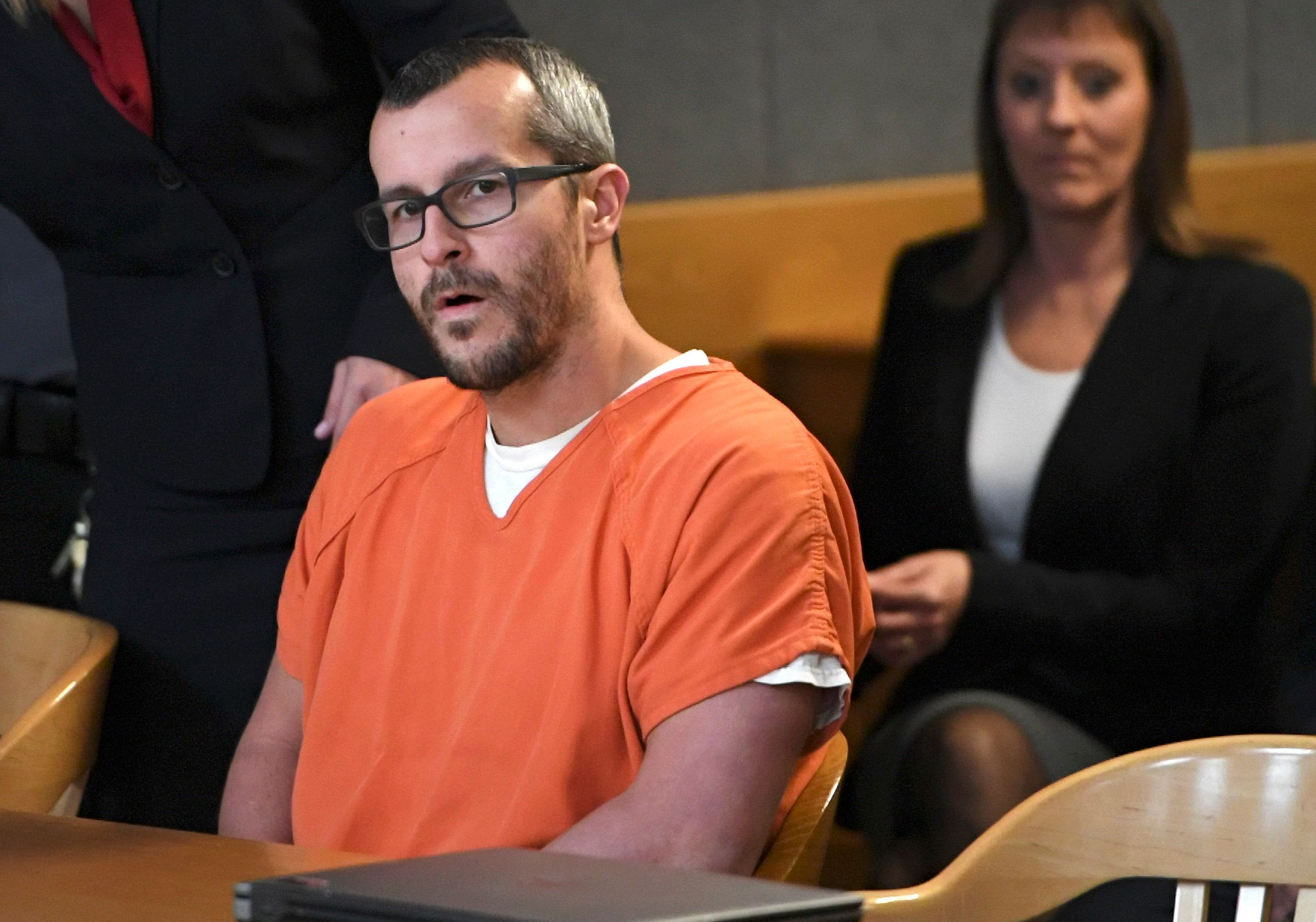FILE - In this Nov. 19, 2018 file photo, Christopher Watts sits in court for his sentencing hearing at the Weld County Courthouse in Greeley, Colo. The family of a Colorado woman murdered by her husband has filed a wrongful death lawsuit, seeking financial damages. Christopher Watts pleaded guilty this month to killing his pregnant wife and their two young daughters and was sentenced to life in prison. (RJ Sangosti/The Denver Post via AP, Pool, File)