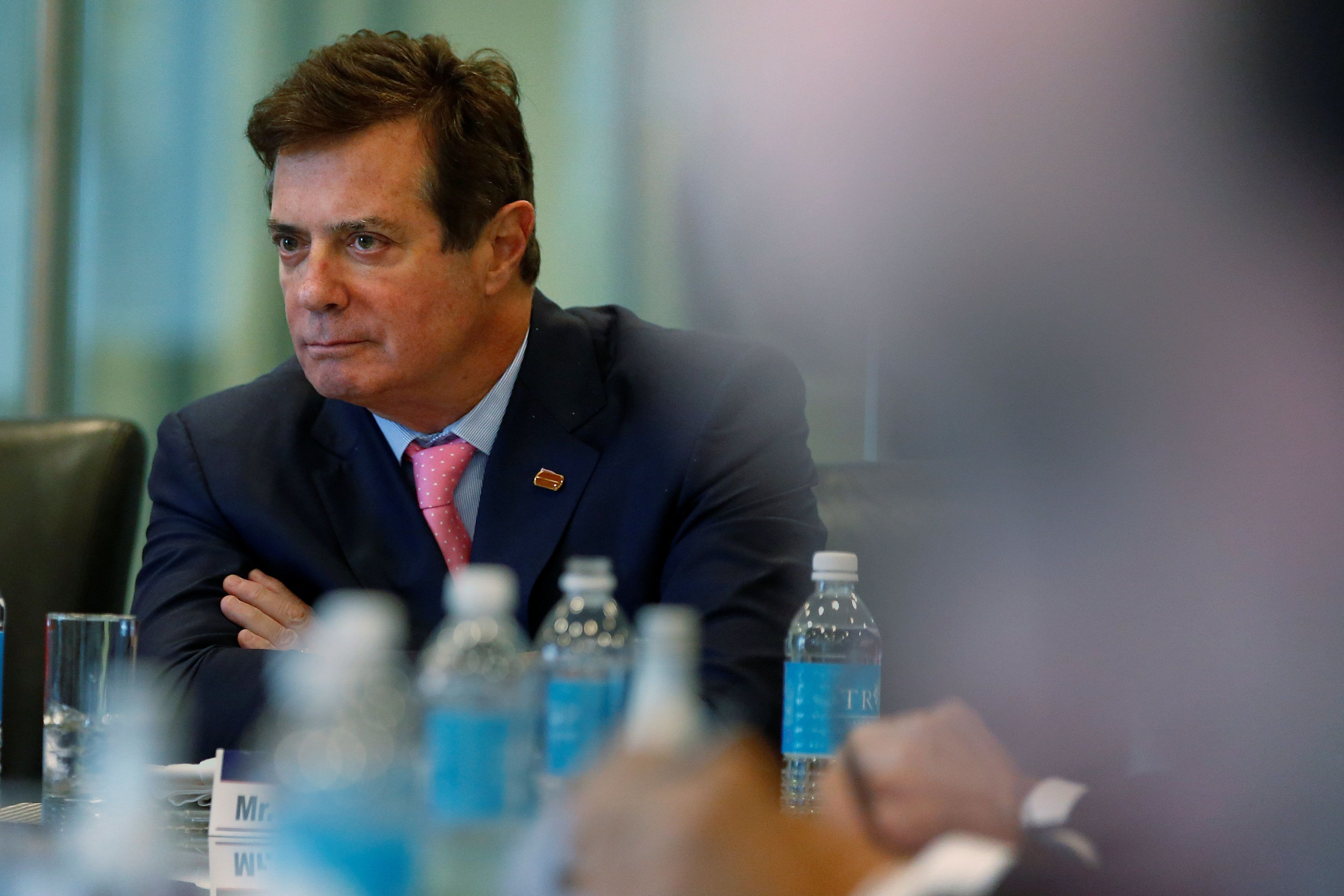 Paul Manafort of Republican presidential nominee Donald Trump's staff listens during a round table discussion on security at Trump Tower in the Manhattan borough of New York, U.S., August 17, 2016. Picture taken August 17, 2016.  REUTERS/Carlo Allegri