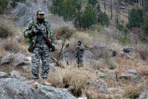 Pakistani soldiers stand guard near the area that India carried out airstrikes on 26