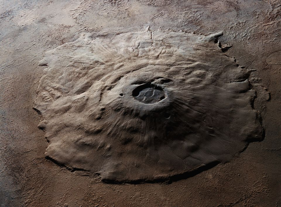 Orbital view of the Olympus Mons volcano on Mars, the largest known volcano in the solar system. It measures...