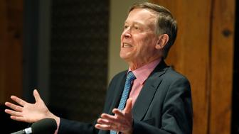 Former Colorado Gov. John Hickenlooper responds to questions during a news conference in the brewpub that he established before his foray into politics Wednesday, March 6, 2019, in lower downtown Denver. Hickenlooper will appear at a sendoff event Thursday in Denver's Civic Center Park to launch his campaign for the Democratic nomination for the presidency in 2020. (AP Photo/David Zalubowski)