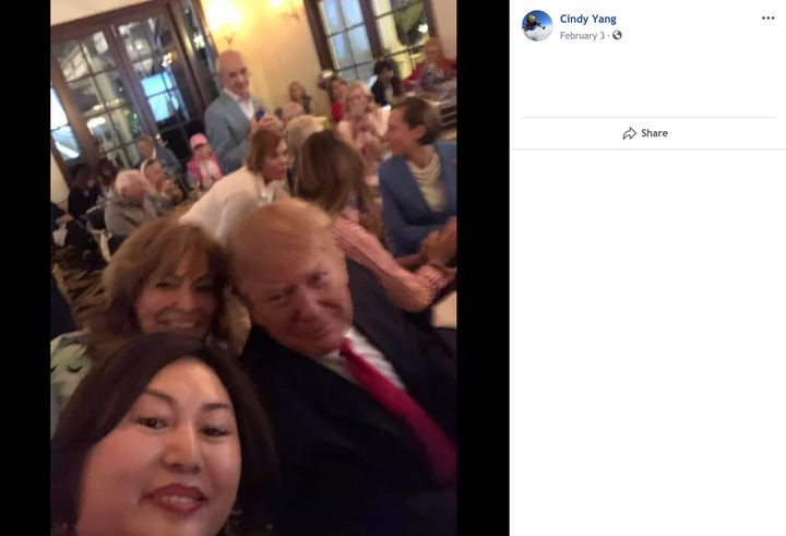 "A screenshot taken from Li ""Cindy"" Yang's Facebook page shows her seated behind the president."
