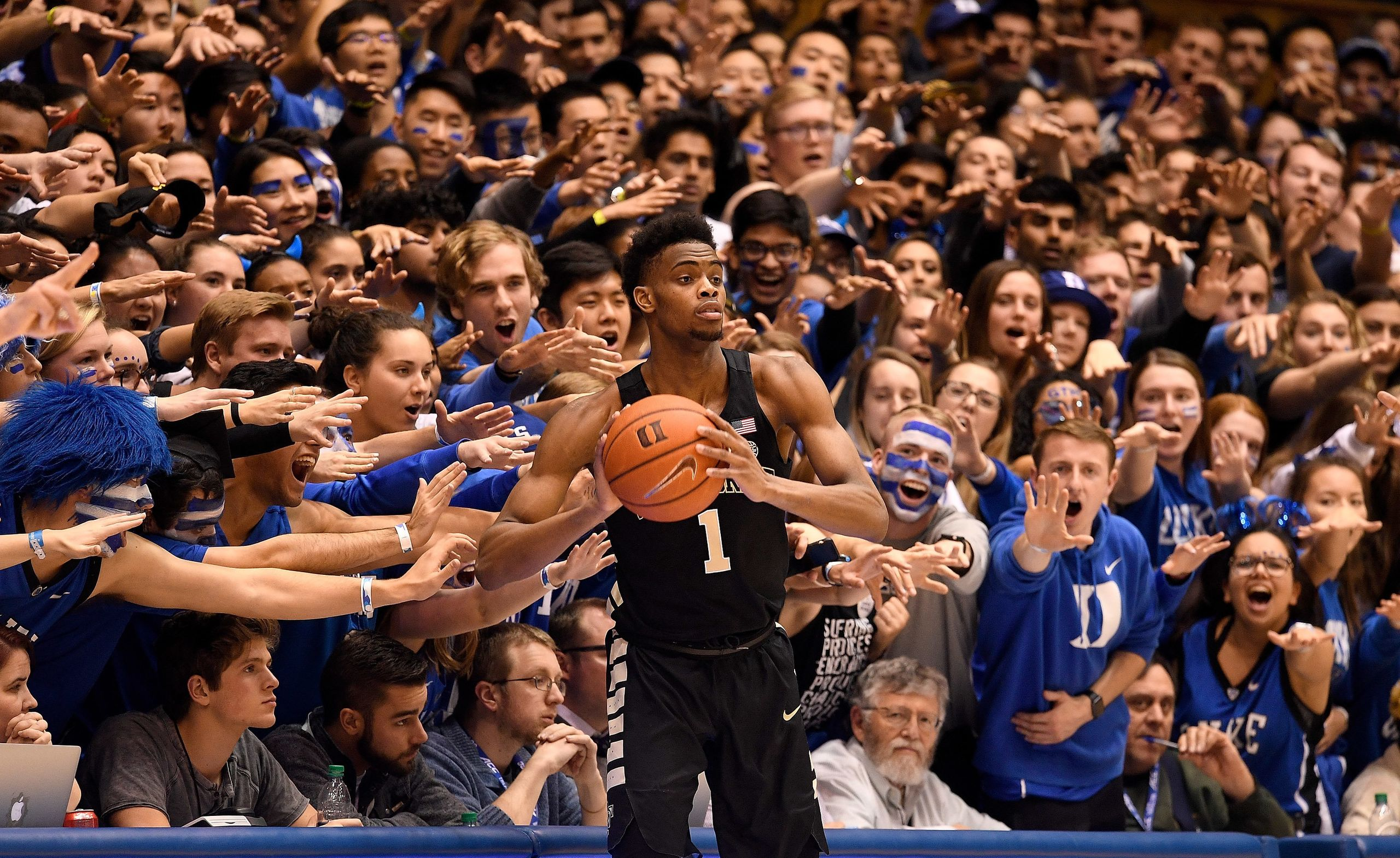 The Cameron Crazies taunt Isaiah Mucius #1 of the Wake Forest Demon Deacons during the second half of their game against the