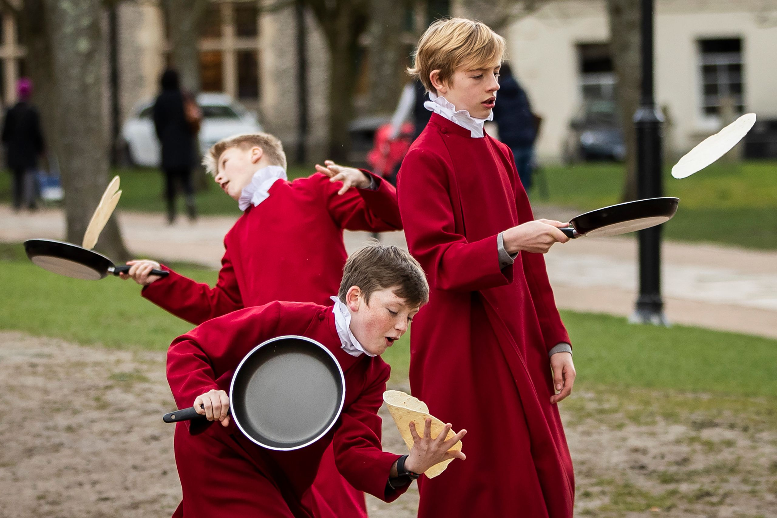 Choristers from Winchester Cathedral joke around in between being posed up for pictures by photographers on March 5, 2019, in