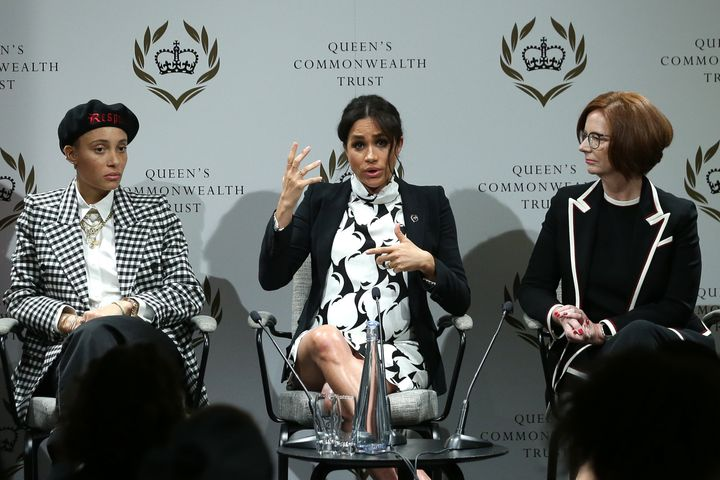 The Duchess of Sussex, flanked by British model Adwoa Aboah and former Australian Prime Minister Julia Gillard, makes a point