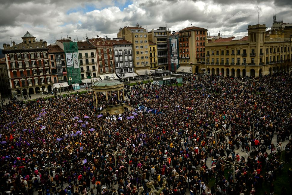 People gather at Plaza del Castillo square during the International Women's Day in Pamplona, in northern Spain.