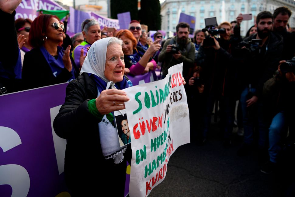 A member of the human rights organization Madres de Plaza de Mayo attends a demonstration marking International Women's Day i