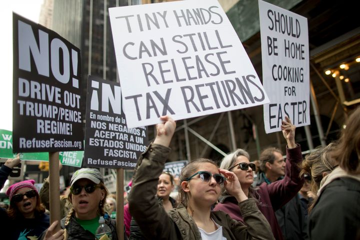 Protesters at nationwide Tax Day protests in April 2017 demanded Trump release his tax returns.