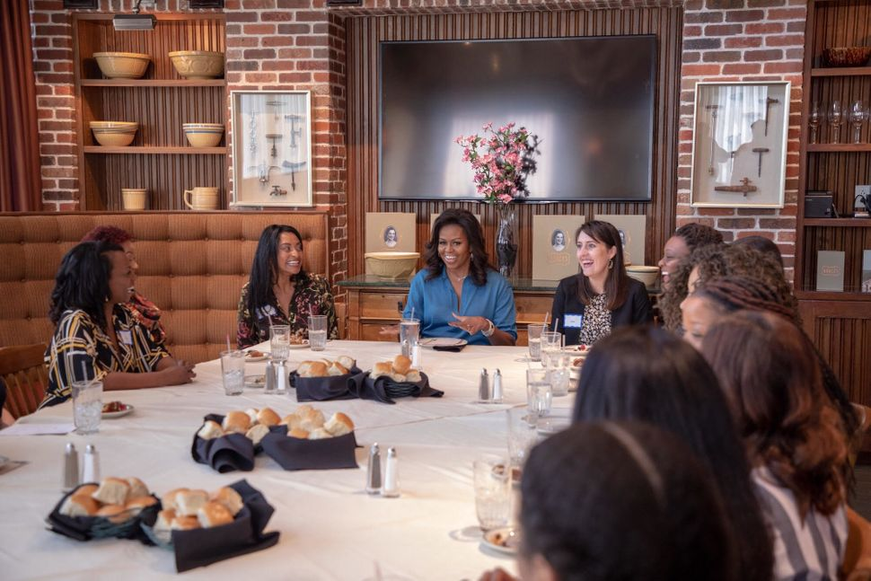 Michelle Obama surrounded by members of my HTX Book and Brunch club.