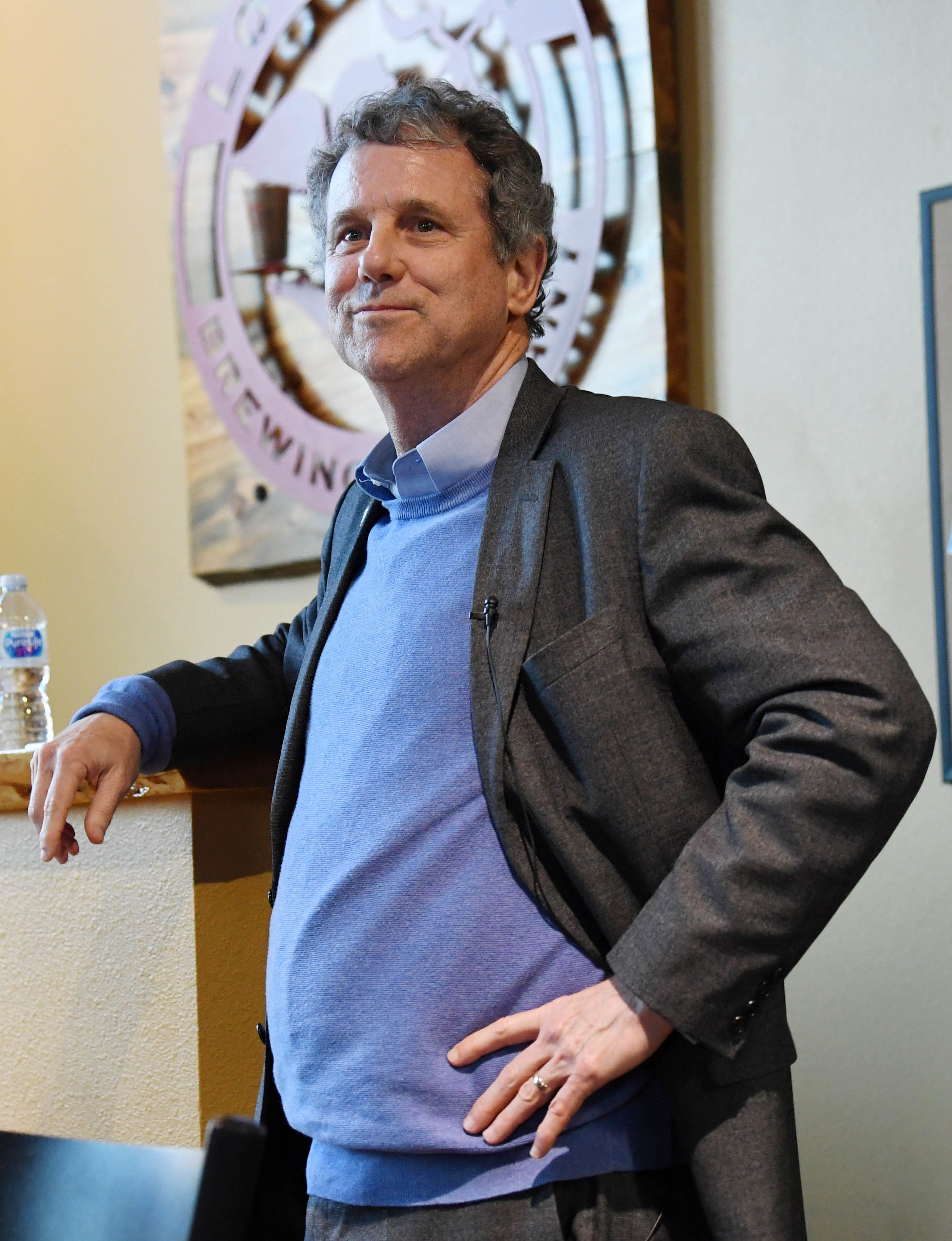 This is a pretty half-hearted smile, Sen. Brown. Do better.