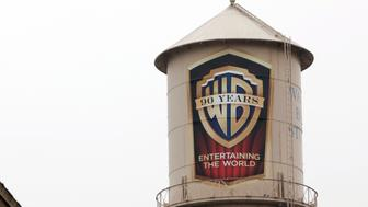 The Warner Bros. logo is displayed on a water tower at  Warner Bors. Studios in Burbank, California, U.S., on on Tuesday, Feb. 5, 2013. Time Warner Inc., the parent company of Warner Bros. Studios, is scheduled to release quarterly earnings data before the opening of U.S. financial markets on Feb. 6. Photographer: Patrick T. Fallon/Bloomberg via Getty Images