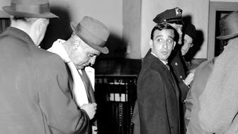UNITED STATES - DECEMBER 13:  Carmine Persico as he is booked at the Bergen Street Precinct police station. He was charged with disposing a gun and a traffic violation after police chase.  (Photo by Charles Frattini/NY Daily News Archive via Getty Images)