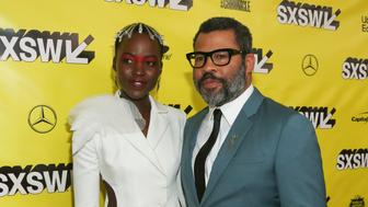 "Lupita Nyong'o, left, and Jordan Peele arrive for the world premiere of ""US"" at the Paramount Theatre on the opening night of the SXSW Film Festival on Friday, March 8, 2019, in Austin, Texas. (Photo by Jack Plunkett/Invision/AP)"