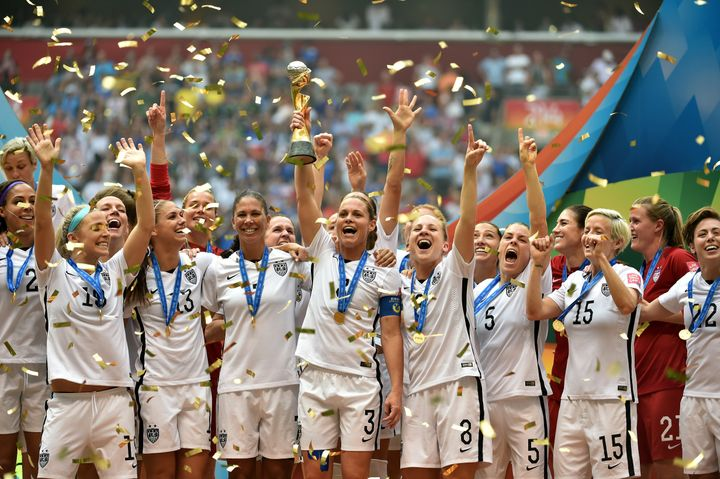 The US Women's soccer team holds the World Cup Trophy after their 5-2 win over Japan in the FIFA Women's World Cup in 2015.