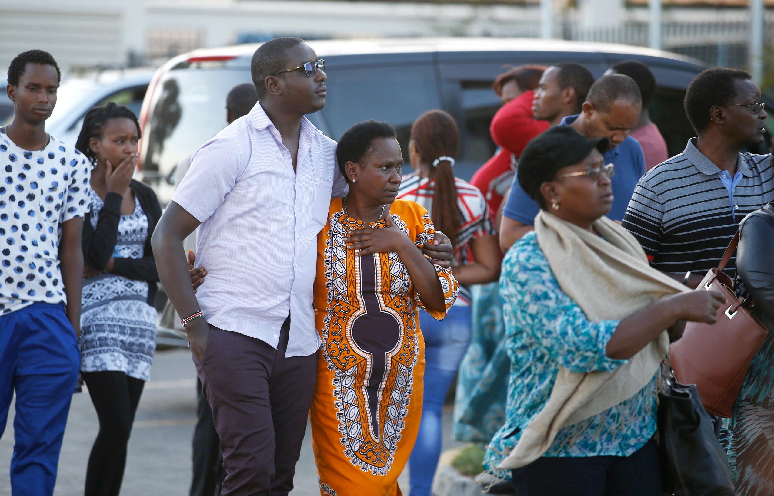 Relatives leave the information center following the Ethiopian Airlines Flight ET 302 plane crash, at the Jomo Kenyatta Inter
