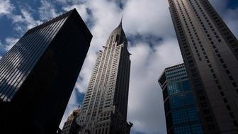 The Chrysler Building, center, stands next to other midtown skyscrapers, Wednesday, Jan. 9, 2019, in New York. The art deco masterpiece that was briefly the world's tallest skyscraper when it was completed in 1930 is up for sale. (AP Photo/Mark Lennihan)
