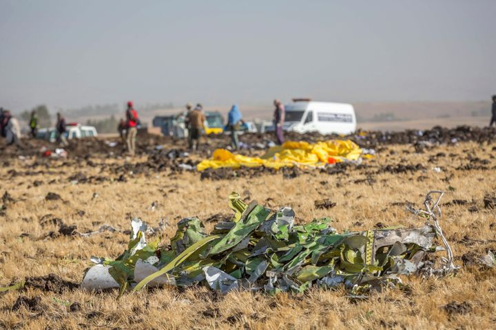 Parts of the plane wreckage with rescue workers at the crash site at Bishoftu, or Debre Zeit, outside Addis Ababa, Ethiopia,
