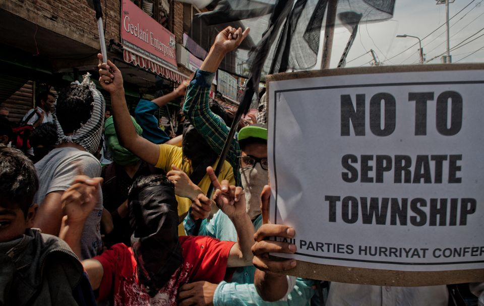 Kashmir Muslim protesters shout anti-India slogans during a protest against setting up of housing colonies...