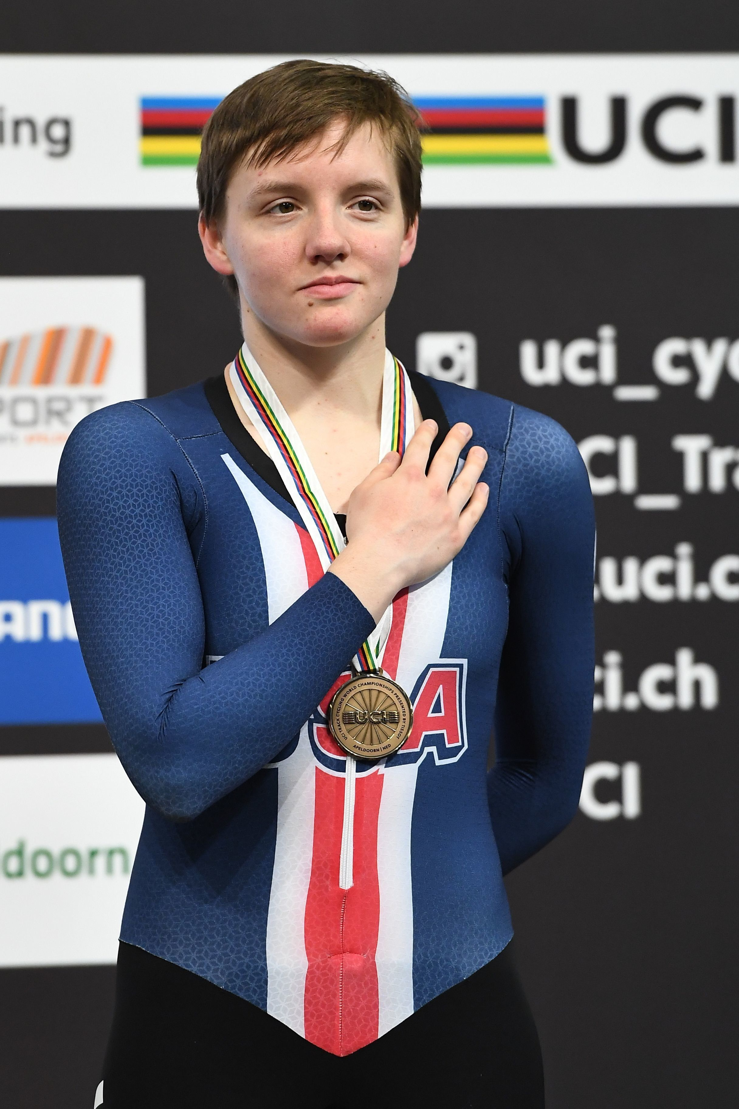 Bronze medallist US Kelly Catlin  poses on the podium after taking part in the women's individual pursuit final during the UCI Track Cycling World Championships in Apeldoorn on March 3, 2018.  / AFP PHOTO / EMMANUEL DUNAND        (Photo credit should read EMMANUEL DUNAND/AFP/Getty Images)