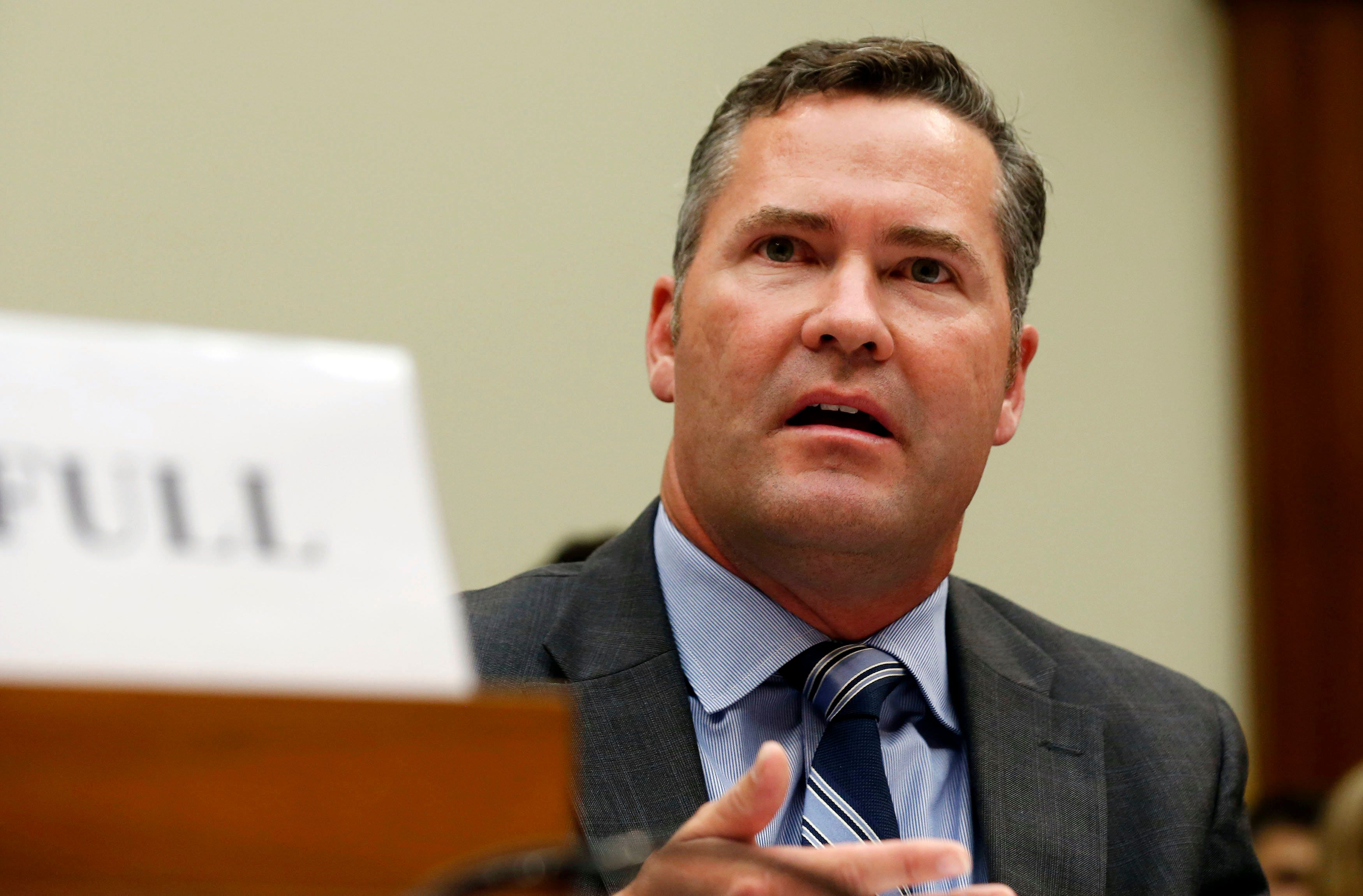 Michael Waltz testifies about his leading a military team and their search efforts for missing soldier Sgt. Bowe Bergdahl, while at a House Foreign Affairs Middle East and North Africa Subcommittee about the exchange of prisoners for Bergdahl while on Capitol Hill in Washington, June 18, 2014.     REUTERS/Larry Downing   (UNITED STATES - Tags: POLITICS MILITARY)