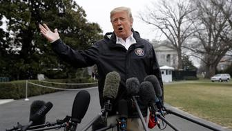 President Donald Trump talks with reporters outside the White House before traveling to Alabama to visit areas affected by the deadly tornadoes, Friday, March 8, 2019, in Washington. (AP Photo/ Evan Vucci)