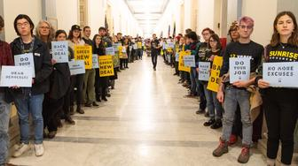Sunrise Movement protest inside the office of US Representative Nancy Pelosi (D-CA) to advocate that Democrats support the Green New Deal, at the US Capitol in Washington, DC on December 10, 2018. (Photo by Michael Brochstein/Sipa USA)