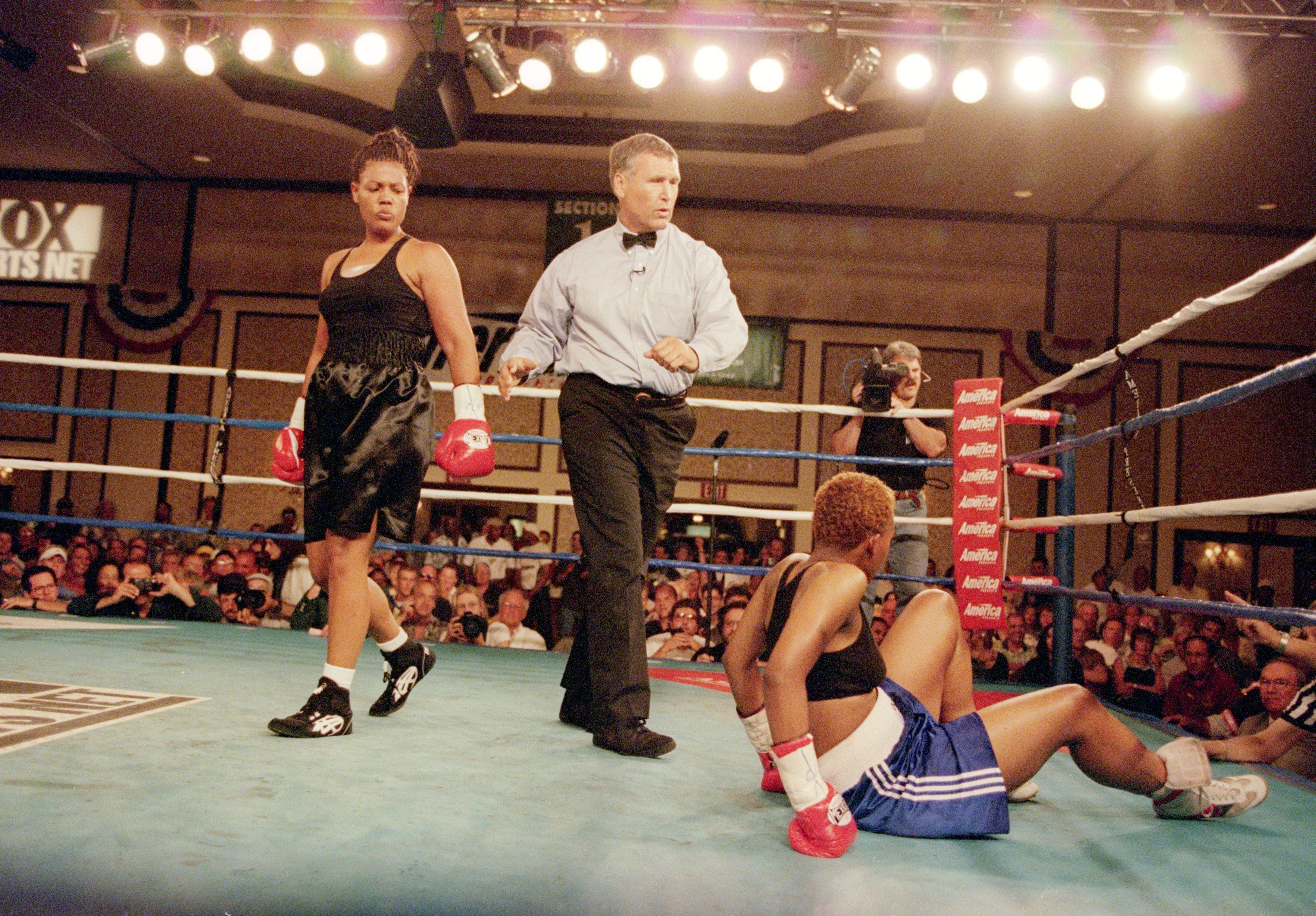 Freeda Foreman peers down at La Quanda Landers during their August 2000 fight