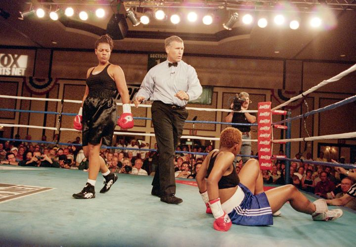 Freeda Foreman peers down at LaQuanda Landers during their August 2000 fight.