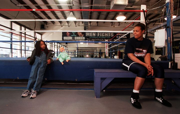 Freeda Foreman took a break from training with her daughter Justice at America Presents Gym in Denver.