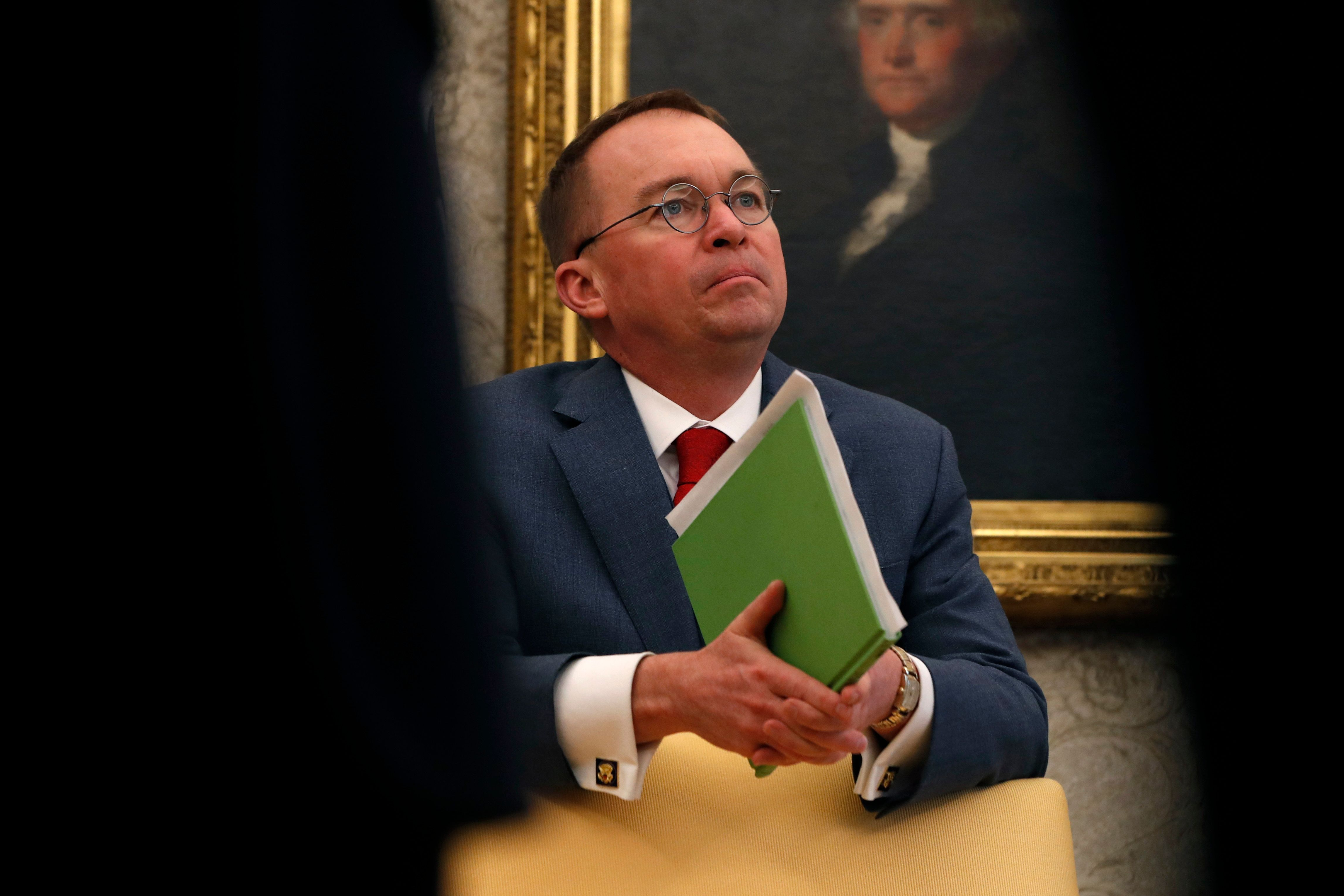 "Acting White House chief of staff Mick Mulvaney listens as President Donald Trump speaks during a meeting with American manufacturers in the Oval Office of the White House, Thursday, Jan. 31, 2019, in Washington. Trump was signing an executive order pushing those who receive federal funds to ""buy American."" (AP Photo/Jacquelyn Martin)"