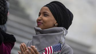 Representative Ilhan Omar, Democrat from Minnesota, applauds during a news conference in Washington, D.C., U.S., on Friday, March 8, 2019. House Democrats are set to approve H.R. 1, a far-reaching elections and ethics bill that would change the way congressional elections are funded, impose new voter-access mandates on states, require groups to publicize donors and force disclosure of presidential candidates' tax returns. Photographer: Alex Edelman/Bloomberg via Getty Images