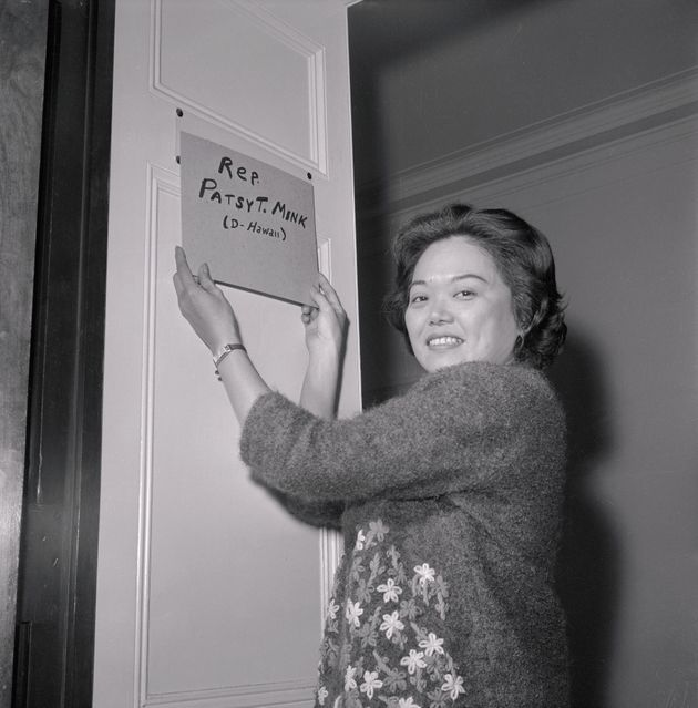 Patsy Mink puts a homemade nameplate on the door of her office after being elected to the 89th