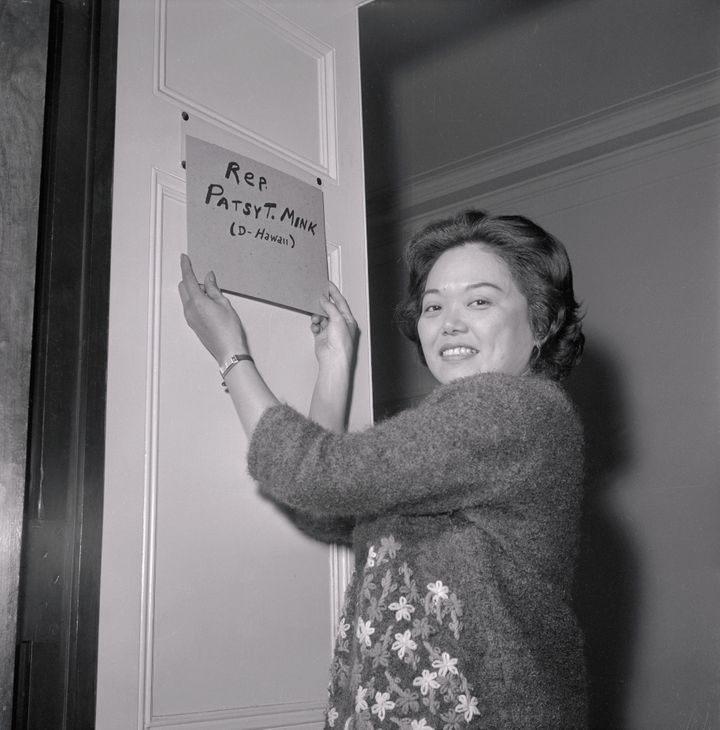 Patsy Mink puts a homemade nameplate on the door of her office after being elected to the 89th Congress.