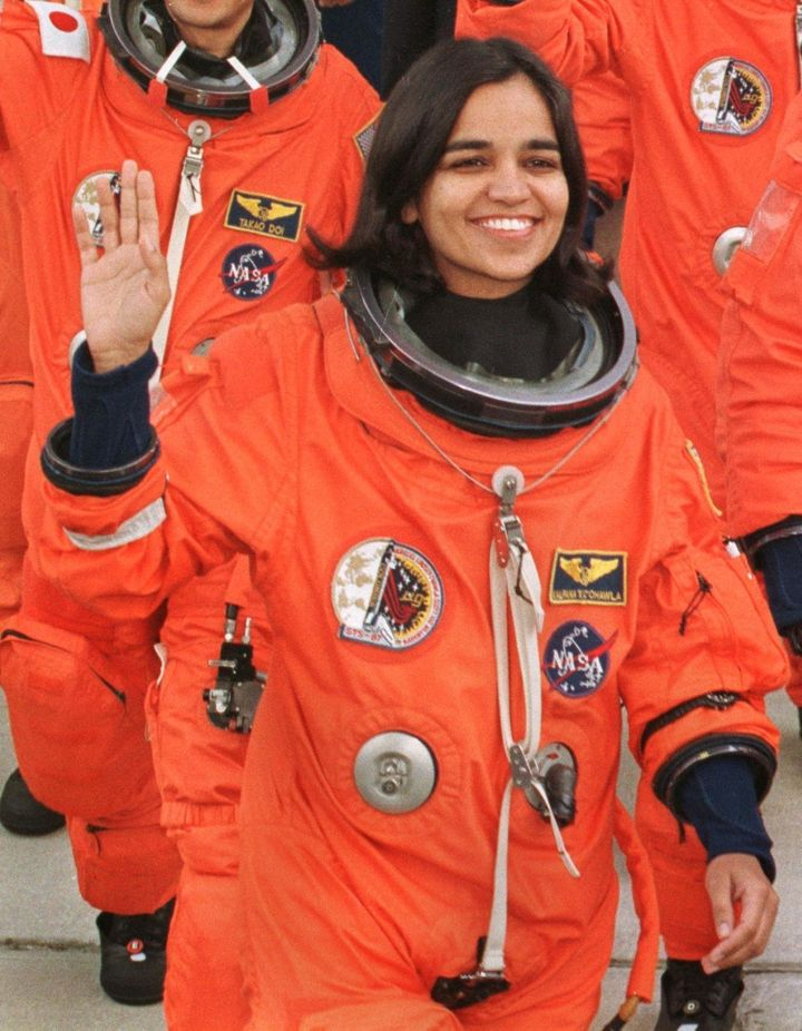 Kalpana Chawla waves to well-wishers as she leaves the Kennedy Space Center's crew quarters to board the shuttle Columbia for launch.