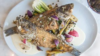 WASHINGTON, DC - SEPTEMBER 14: Whole Fried Black Bass  Fish sauce stir fry, lentils & green curry aioli at Whaleys.  (Photo by Dixie D. Vereen/For The Washington Post via Getty Images)