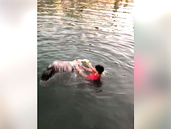 Hunter Hardesty grabs a pelican