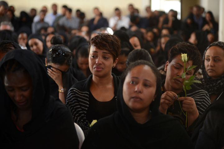 Mourners attend a memorial service Monday for Ethiopian Airlines crew members and other victims of the crash near Addis Ababa