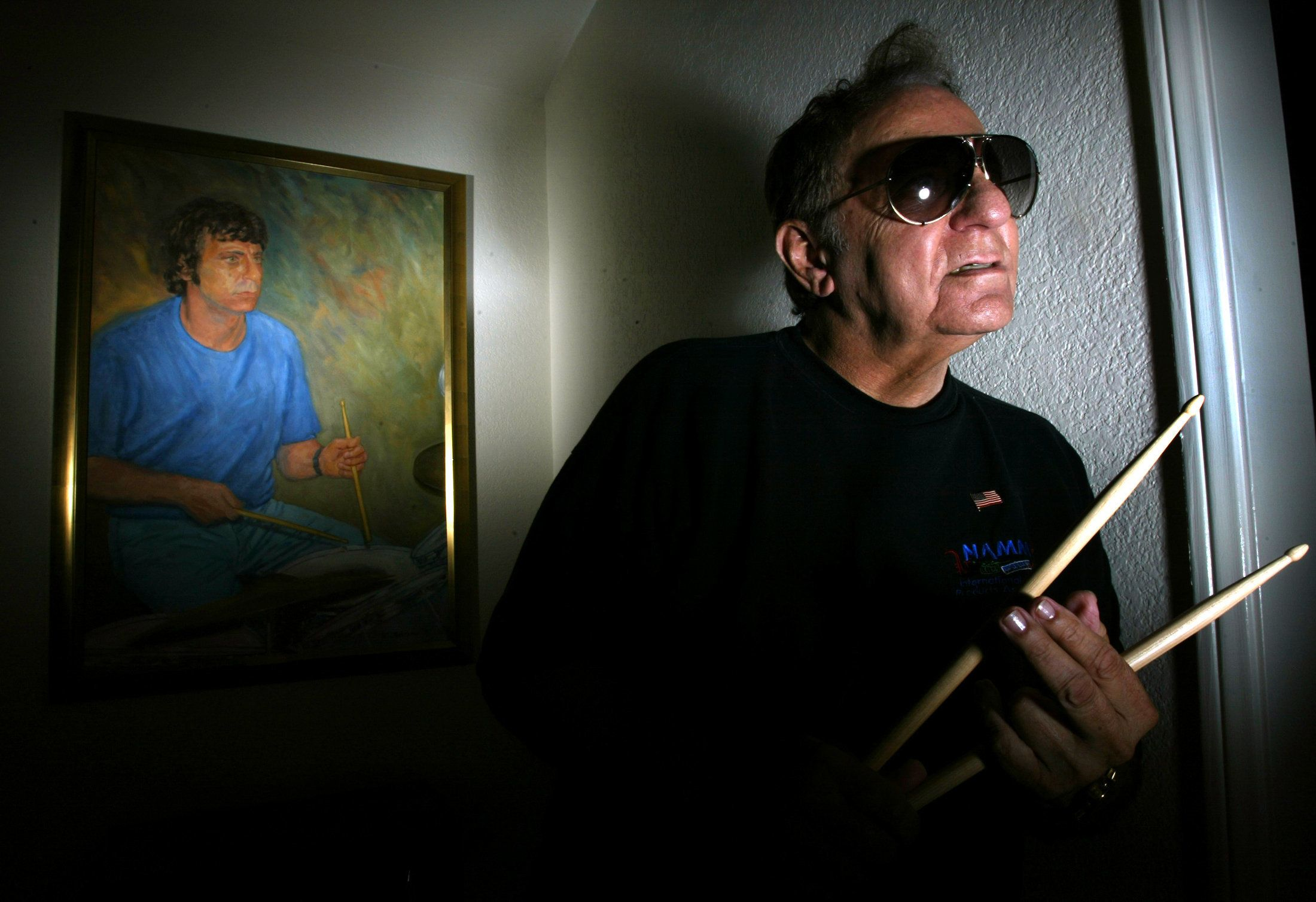 Hal Blaine,74, one of the most famous drummers in the history of pop music, poses in front of an oil painting of himself in younger days at his home in Palm Desert.  (Photo by Gina Ferazzi/Los Angeles Times via Getty Images)