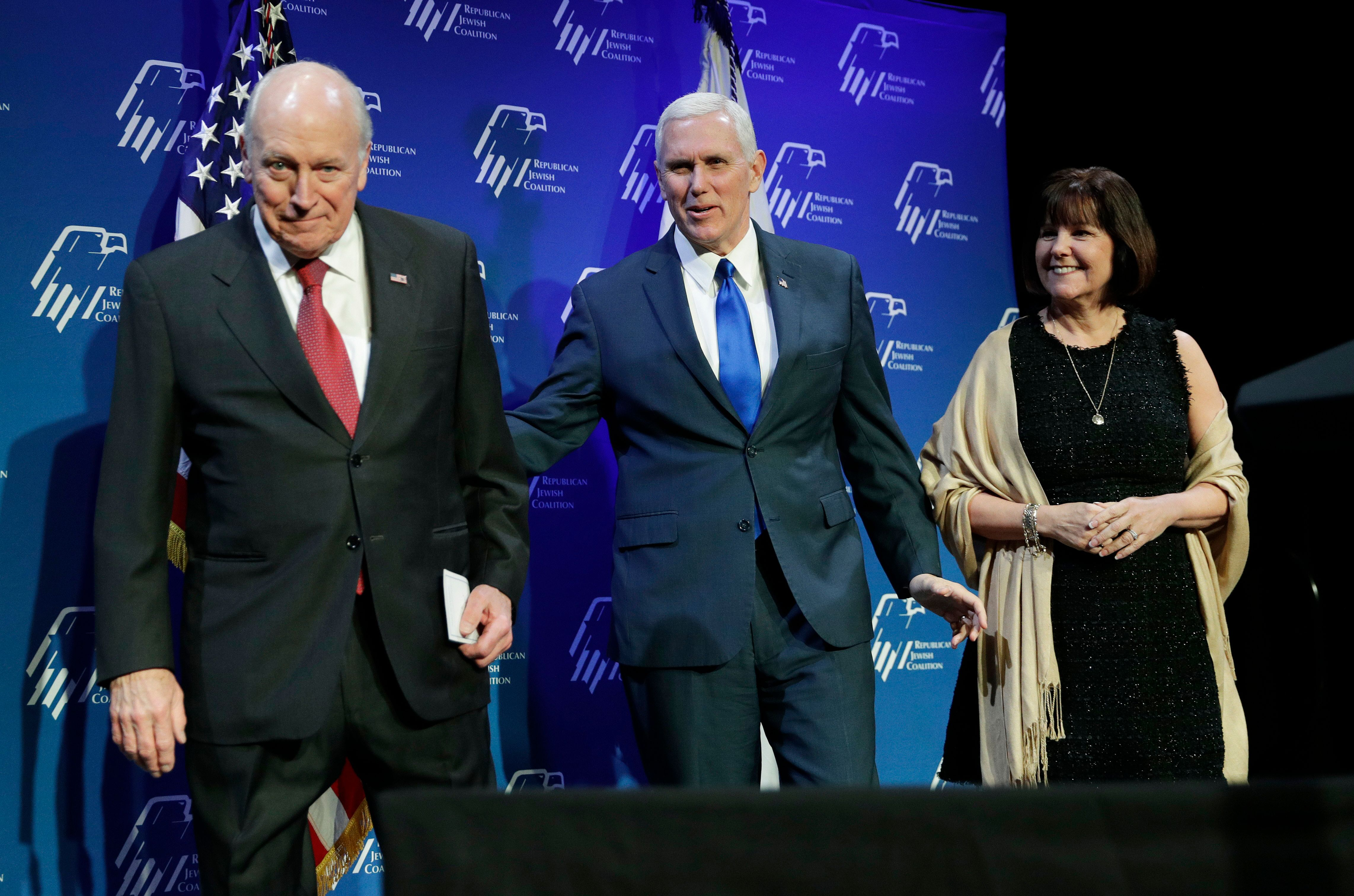 Vice President Mike Pence, center, takes the stage with his wife Karen Pence, right, after they were introduced by former Vice President Dick Cheney, left, at the Republican Jewish Coalition annual leadership meeting, Friday, Feb. 24, 2017, in Las Vegas. (AP Photo/John Locher)