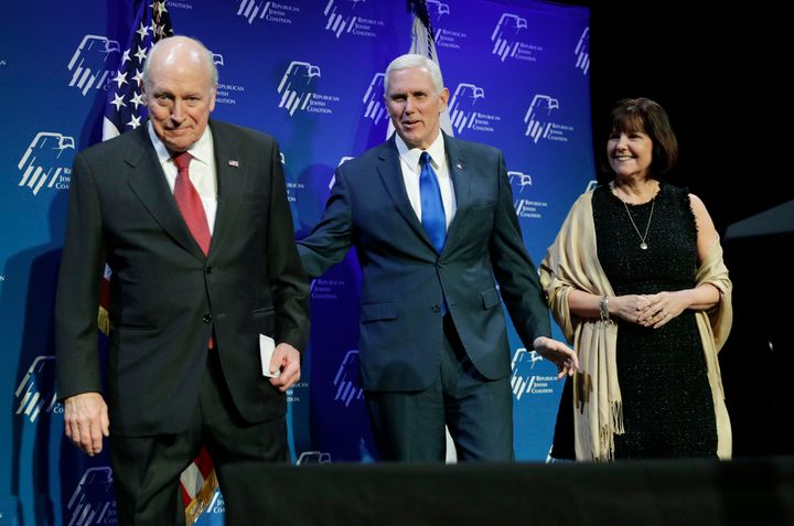 Vice President Mike Pence, center, takes the stage with his wife Karen Pence, right, after they were introduced by former Vic