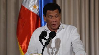 Philippine President Rodrigo Duterte delivers his speech during the presentation ceremony of the signed document on the Organic Law for Bangsamoro Autonomous Region of Muslim Mindanao to officials of the Moro Islamic Liberation Front (MILF) at Malacanang palace in Manila on August 6, 2018. - President Rodrigo Duterte unveiled a law on August 6 granting greater autonomy to the Philippines' Muslim south, as he expressed hope the measure will at last end decades of bloody separatist conflict. (Photo by TED ALJIBE / AFP)        (Photo credit should read TED ALJIBE/AFP/Getty Images)