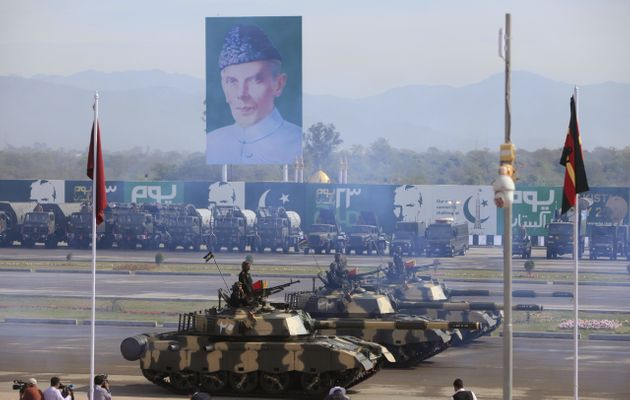 Pakistani armed forces in tanks take part during the Pakistan Day military parade in