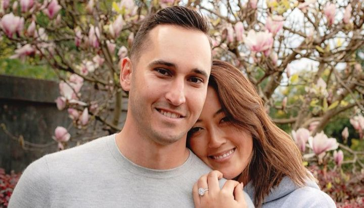 Jonnie West and Michelle Wie are all smiles as the golf champ shows off her engagement ring.