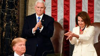 Feb 5, 2019; Washington, DC, USA; Speaker of the House Nancy Pelosi (D-Calif.) claps to President Donald Trump as he delivers the State of the Union address from the House chamber of the United States Capitol in Washington. Vice President Mike Pence is behind Trump. Mandatory Credit: Jarrad Henderson-USA TODAY NETWORK/Sipa USA