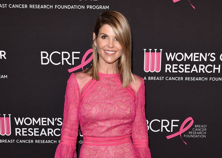 Court documents say Lori Loughlin and her husband agreed to pay $500,000 in exchange for having their two daughters recr
