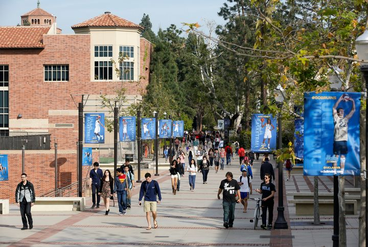 In this Feb. 26, 2015, file photo, students walk on the University of California, Los Angeles campus.