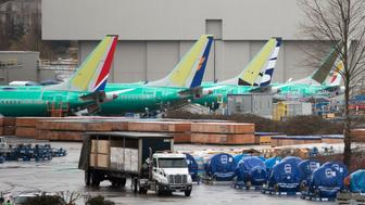 Boeing 737 airplanes, including one for Ethiopian Airlines, fourth from left, are pictured at the Boeing Renton Factory in Renton, Washington on March 12, 2019. - The US said there is 'no basis' to ground Boeing 737 MAX airplanes, after a second deadly crash involving the model in less than five months prompted governments worldwide to ban the aircraft. 'Thus far, our review shows no systemic performance issues and provides no basis to order grounding the aircraft,' Federal Aviation Administration (FAA) chief Daniel Elwell said in a statement. (Photo by Jason Redmond / AFP)        (Photo credit should read JASON REDMOND/AFP/Getty Images)