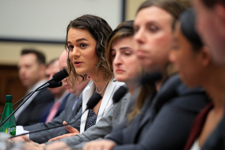 Army Capt. Alivia Stehlik, fourth from right, together with other transgender military members testify about their service be