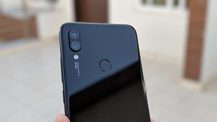 Redmi Note 7 Pro rear view of cameras and fingerprint sensor.