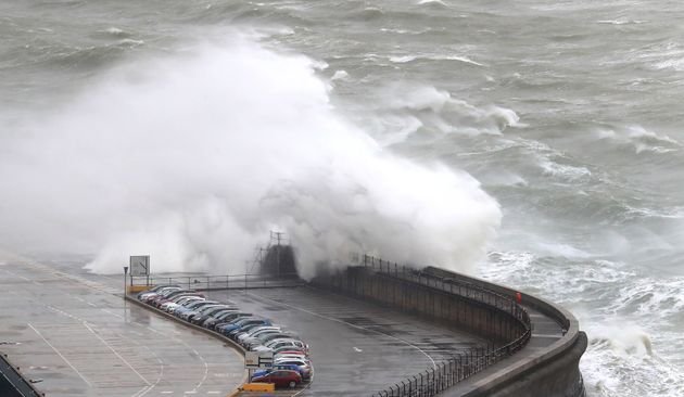 Waves crash onto cars on the harbour arm at the Port of Dover in Kent as Storms Gareth sweeps across...